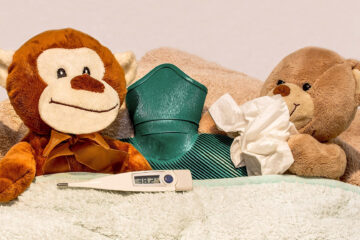 Acupunture for colds and immunity featuring stuffed animals in bed sick