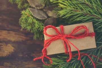 holiday gift in evergreen tree for massage